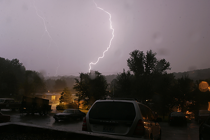 A lightning bolt strikes the ground in rural St. Louis while the area is under a tornado warning. ©2010 Max Gersh