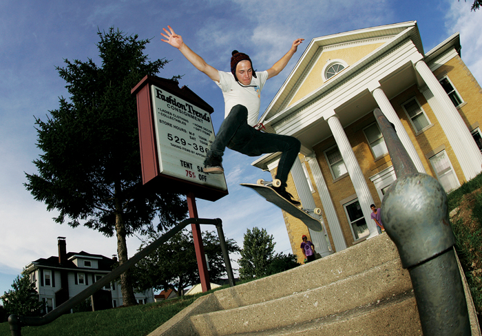 Ethan Jester does a kickflip down a set of steps in front of Fashion Trends Consignment Shop in New Castle Wednesday evening. (C-T photo Max Gersh) ©2010