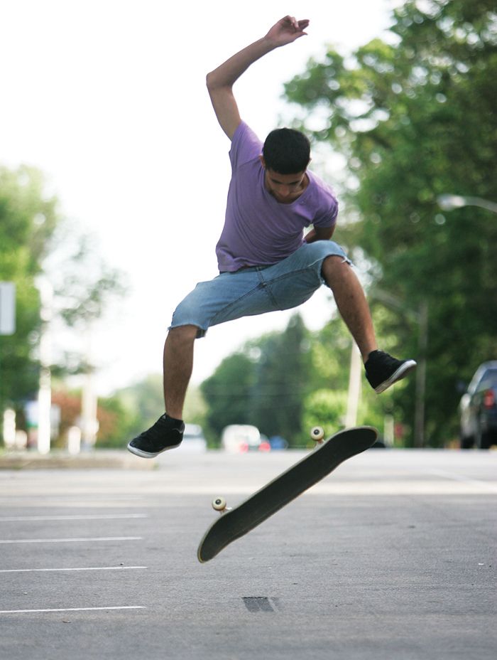 "Alex Chamberlin practices a 360 kickflip in a Baker Park parking lot Wednesday evening. ""This is the only place we really don't get in trouble for skating,"" said Chamberlin. (C-T photo Max Gersh) ©2010"