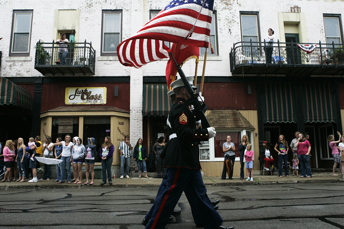 U.S. Marines carry flags down Main Street in Middletown Tuesday evening as part of the parade during the Middletown Lions Club Fair. (C-T photo Max Gersh) ©2010