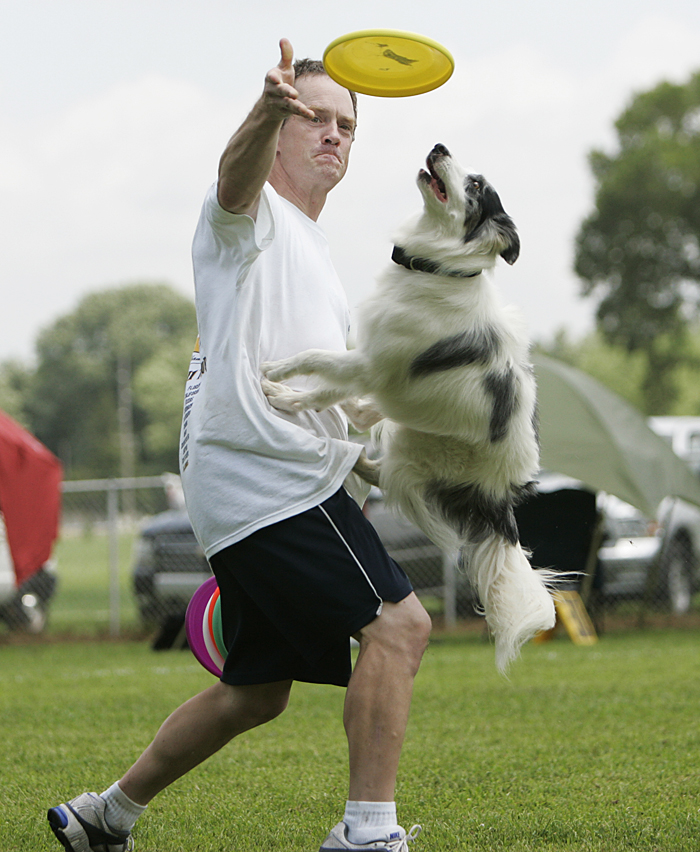 Chip Baker of Detroit, Michigan competes in the expert freestyle event with his dog, Seeker, at the Skyhoundz North Central Regional championship in Osborne Park. (C-T photo Max Gersh) ©2010