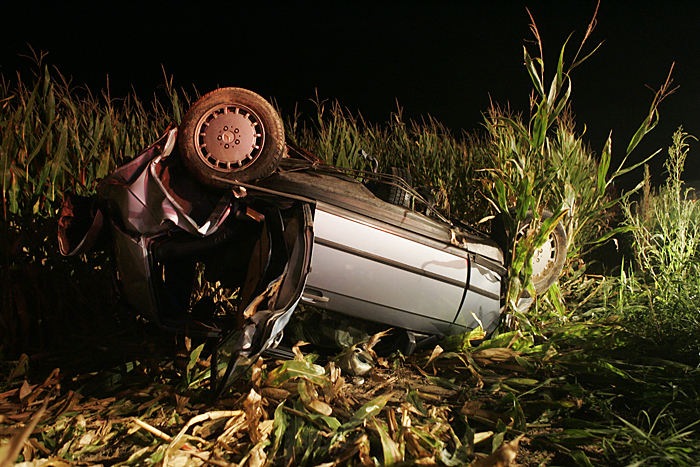 A 1987 Mercedes Benz lies mangled in a cornfield late Wednesday night after crashing near the intersection of Road 300S and Ind. 103. (C-T photo Max Gersh) ©2010