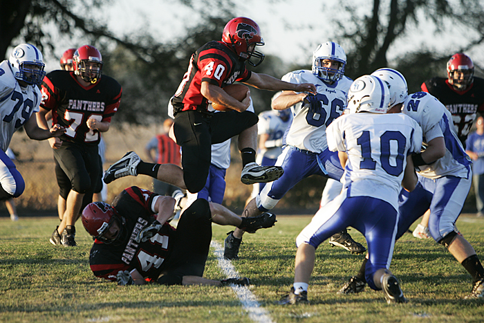 Knightstown's Danny Ortman hurdles a teammate during a drive against the Eastern Hancock Royals. Ortman was one of two Knightstown rushers to earm more than 100 yards on the ground. (C-T photo Max Gersh) ©2010