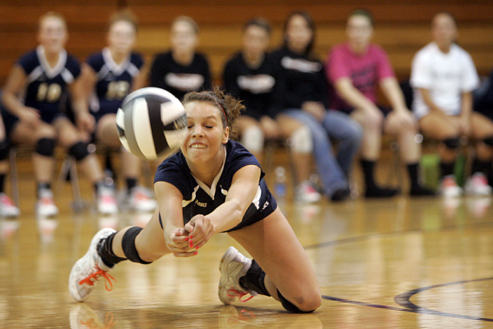 Makayla Roseberry of Shenandoah dives for the ball Tuesday night during the regional match against Muncie Burris. (C-T photo Max Gersh) ©2010