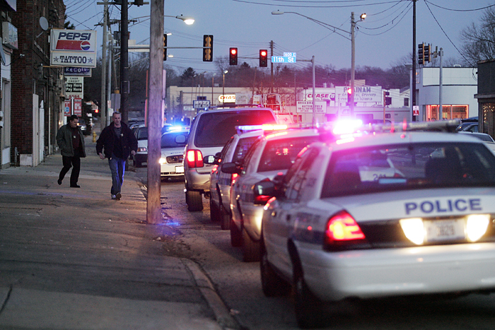 MAX GERSH | ROCKFORD REGISTER STAR ©2011 Police officers leave The Happy Shop Thursday, Jan. 6, 2011,  after responding to a shooting on the 1500 block of Broadway in Rockford.