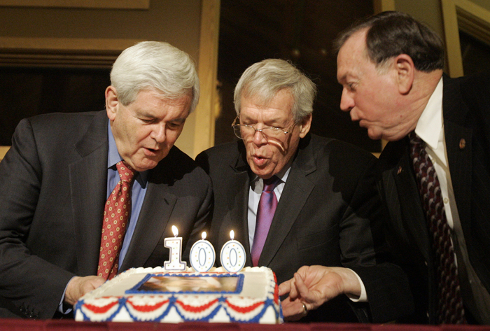 MAX GERSH | ROCKOFRD REGISTER STAR Former Speakers of the House Newt Gingrich (left) and Dennis Hastert and State Rep. Jerry Mitchell blow out the candles on a cake Friday, Feb. 4, 2011, for President Ronald Reagan's 100th birthday celebration at Deer Valley Golf Club in Deer Grove. ©2011