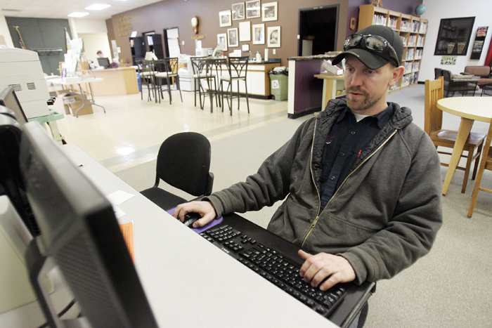 MAX GERSH | ROCKFORD REGISTER STAR Luke Nevdal uses the internet Tuesday, March 1, 2011, on a computer at the Pecatonica Library. Nevdal's laptop is in for repair and he has been using the library's computers to access his e-mail. ©2011