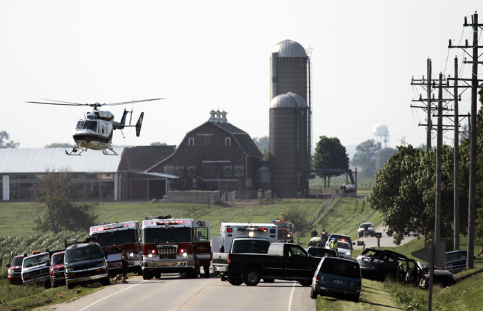 MAX GERSH | ROCKFORD REGISTER STAR A helicopter takes off from the scene of a two-vehicle accident Thursday, June 30, 2011, on Genoa Road near Fern Hill Road in Boone County. ©2011