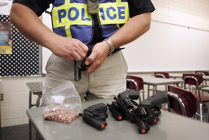 MAX GERSH | ROCKFORD REGISTER STAR Chief of Police for the Rock Valley College Police Department Joe Drought loads starter pistols Wednesday, Aug. 10, 2011, during rapid deployment to an active shooter training at Harlem High School in Machesney Park. ©2011