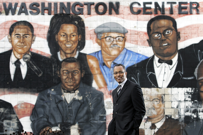 "MAX GERSH | ROCKFORD REGISTER STAR Booker Washington Community Center board president Robert King stands near a mural on the south side of the facility Thursday, Oct. 13, 2011, in Rockford. King says he wants to put a new mural up in its place within the coming year. ""I love the past but I want to bring the simplicity back to the center and bring it back to Booker Washington himself,"" King said. © 2011"
