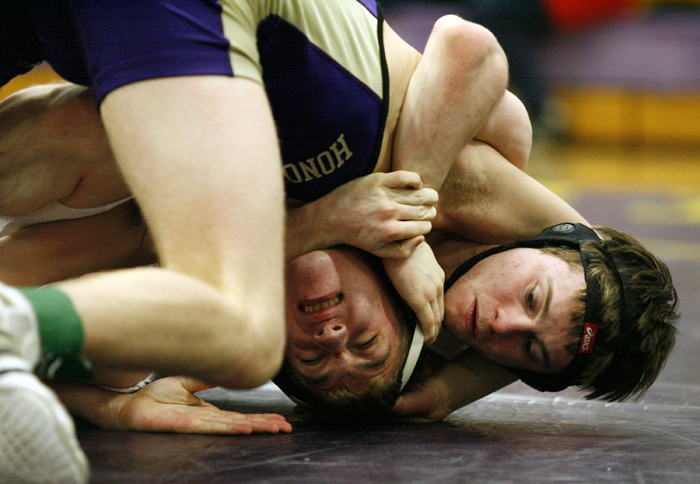Hononegah's Josh Lawyer (left) works to get free from Freeport's Allan Hornung in the 138-pound fifth place bout Saturday, Jan. 26, 2013, during the NIC-10 conference wrestling meet at Hononegah High School in Rockton. Lawyer went on to win the bout. MAX GERSH/ROCKFORD REGISTER STAR ©2013