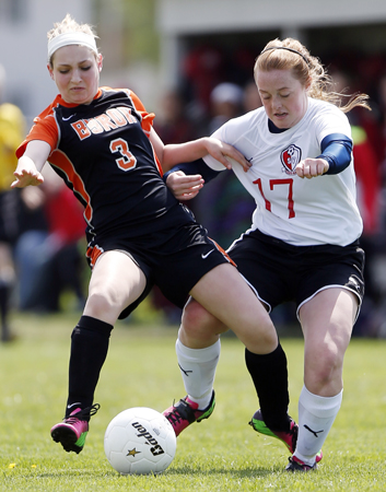 Byron's Kellyn Euhus (3) is knocked off balance while fighting for the ball with Stillman Valley's Carley Frost (17) Saturday, May 11, 2013, during a game at Stillman Valley High School. MAX GERSH/ROCKFORD REGISTER STAR ©2013