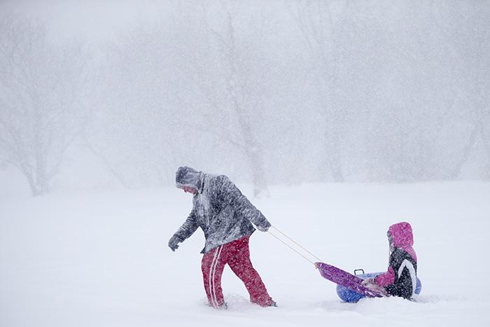 Sledding in heavy snow