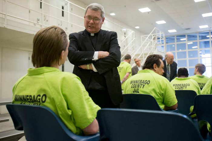 Bishop David J. Malloy talks with Nathanial Davis on Sunday, March 27, 2016, after Easter Mass at the Winnebago County Jail in Rockford. MAX GERSH/STAFF PHOTOGRAPHER/RRSTAR.COM ©2016