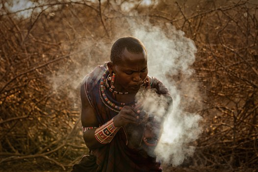 We visited a Maasai village in the Selenkay Conservancy near Amboseli National Park in Kenya. This warrior was making a fire in the traditional way - by rubbing together sticks and donkey dung. Canon 5D Mark II, Canon 70-200 f/2.8, ISO 400, f/6.3, 1/320 sec - By Sean Morris, Cape Town