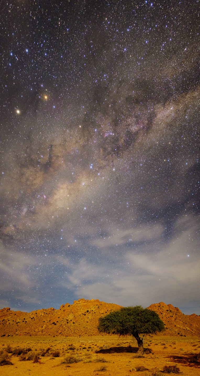 This is a vertical panorama stitched out of four exposures placed one above the other. The images were taken at Klein-Aus Vista, Namibia, in moonlit conditions. The shoot was part of the Aus Photography Workshop co-presented with JJ van Heerden and Wicus Leeuwner. Fuji X100s, 23mm f/2, ISO 3200, f/2, 4 x 30 sec exposures