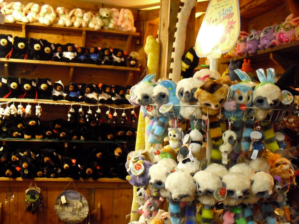 stuffed animals displayed to the rafters in General Store - stuffed bunnies, monkeys and other animals on shelves