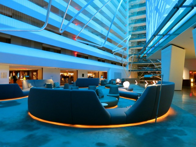 Conrad Hotel NYC lobby in teal light