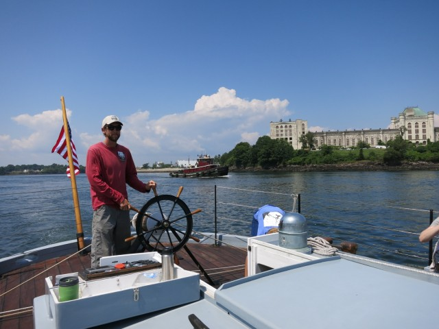 "Gundalow Captain sailing past the crumbling but still grand decommissioned Naval prison referenced in the movie ""The Last Detail"" - Portsmouth Harbor NH"