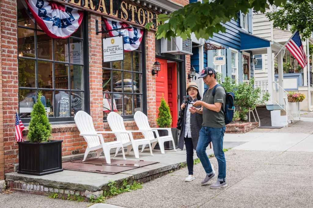 Visitors snap a selfie in front of Cold Spring General Store in Cold Spring NY.