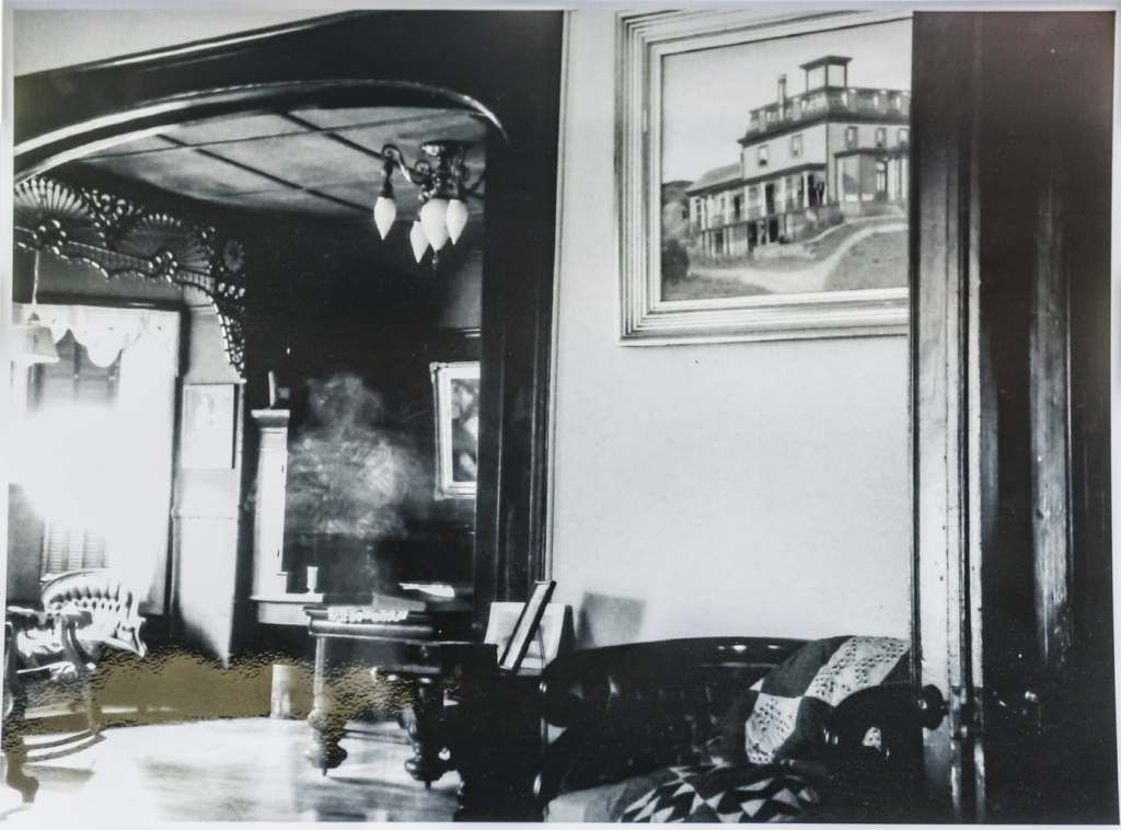 Black and white photo of Dr Best House interior that appears to show a ghost.