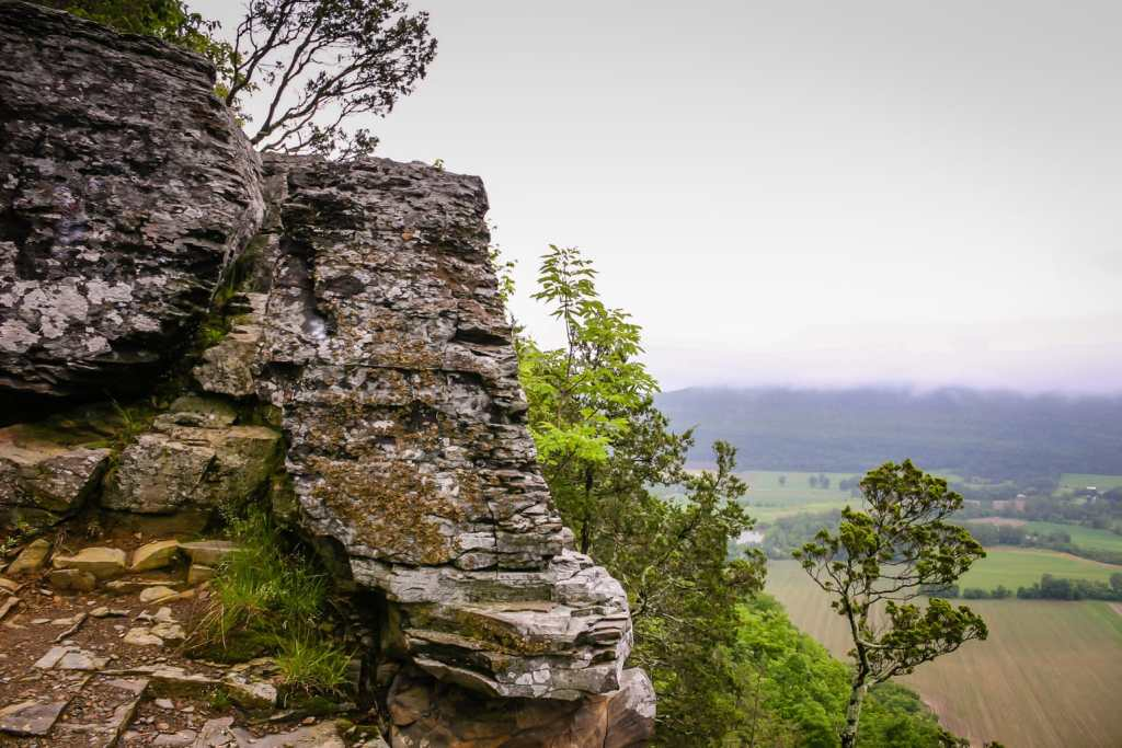 Rock cliff shaped like a nose overlooking Schoharie Valley at Vromans Nose Nature Preserve in Upstate New York.