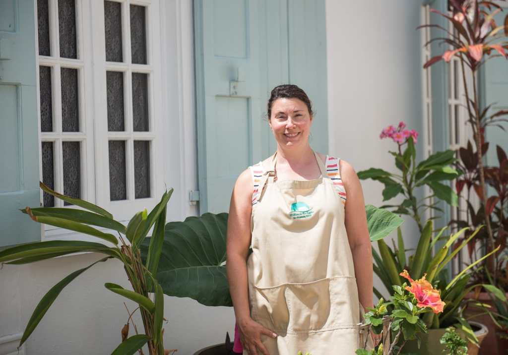 Jessica Geller, owner of At Home In the Tropics B and B, poses in the garden of the bed and breakfast in St. Thomas USVI