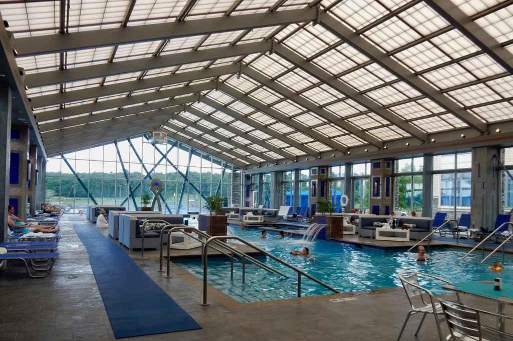 Huge indoor pool in glass enclosure at Mount Airy Casino Resort