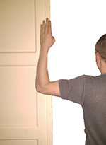 Showing arm against door with elbow 90 degrees