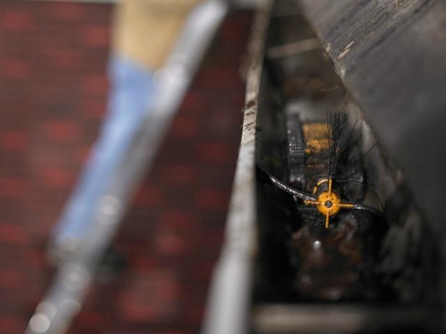 iRobot Looj cleaning the gutters