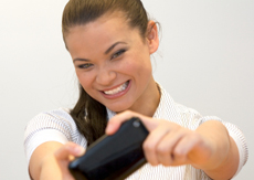 Woman playing game on mobile phone