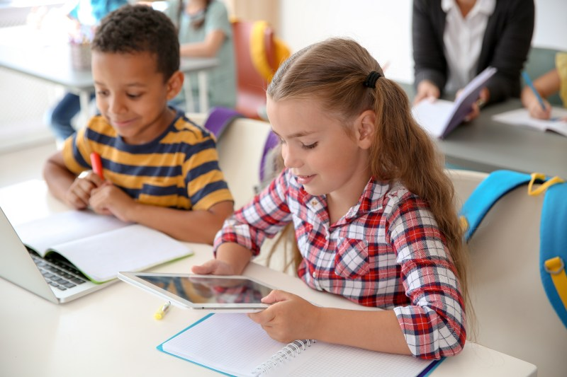 Kids reading in the interACTIVE classroom