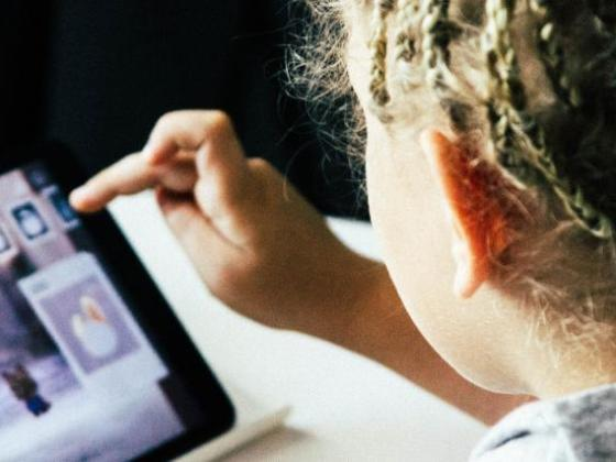 Child learning on a tablet.