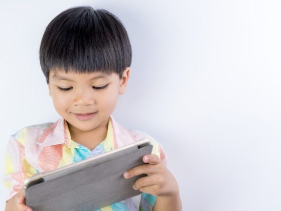 Kid reading on tablet