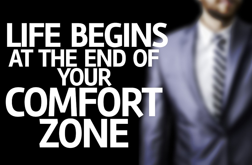 Life Begins at the end of Your Comfort Zone written on a board w