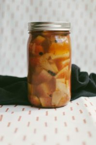 Close up on jar of pickling watermelon rind against a cloth background - The Mummy