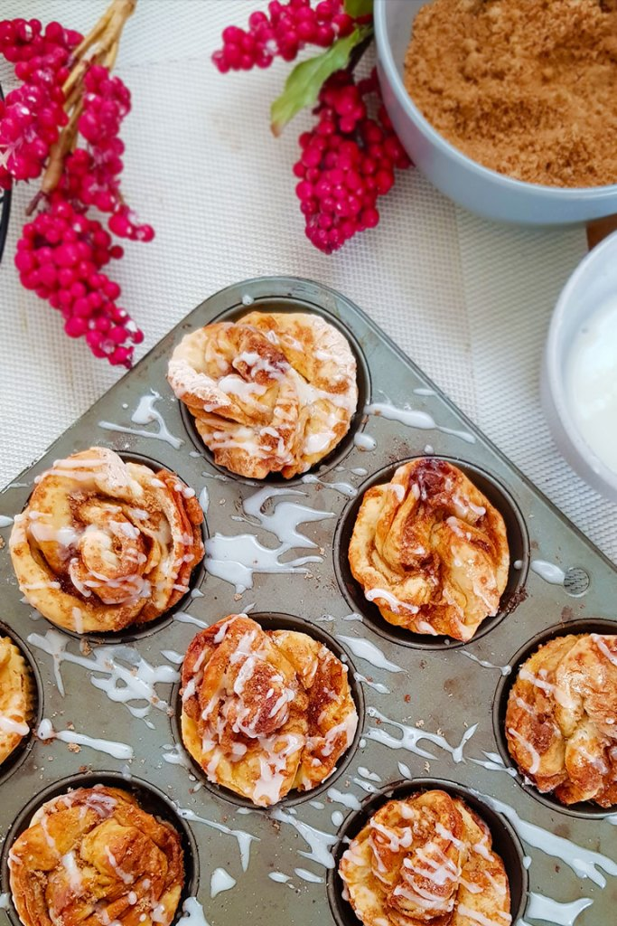 vegan holiday breakfast muffins with glaze topping