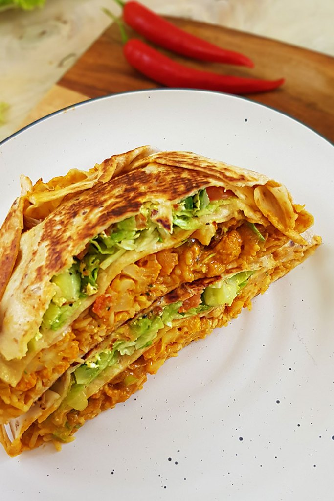 vegan crunchwrap in plate top side view