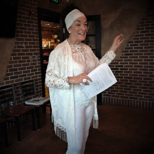 Nancy dressed in all white teaching about psychic abilities