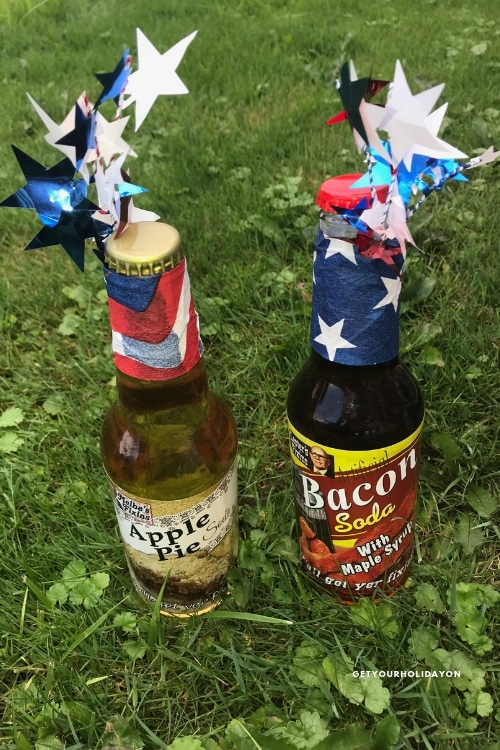 Decorate a six pack with a holiday theme and hand out individual beers or flavored sodas as adult party favors.