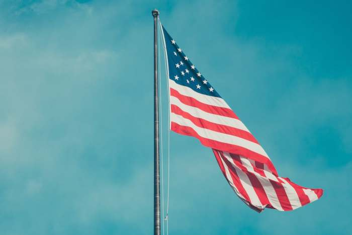 11 Fun Traditions (With A Patriotic Twist) Take a moment with your entire family and gather around to raise the flag.