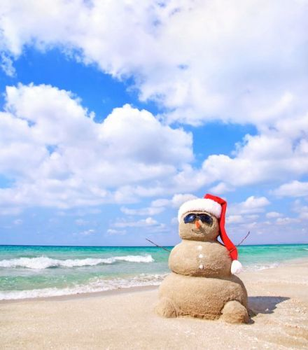 Instead of building a snowman in the snow go to the beach with the family and build a snowman in the sand. Not only will this make for totally cute pictures but it will make for a really great memory!