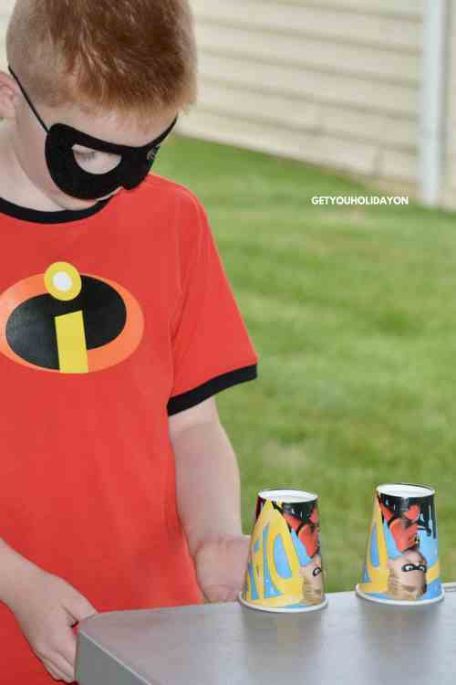 Zap! Pow! Bam! Show the kids to the Jesus Superhero Training Academy with these Superhero games. You will find games and activities from Flip the Cup to Balloon Smash. Go here for more details!  #superhero #diycrafts #momlife #church