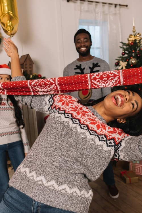 Adult Holiday Party Games including favorites like this Holiday Limbo Game!