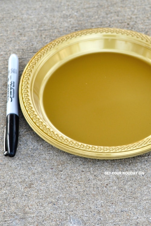 First, for the Hilarious Leprechaun Gold Game you will need to come up with Leprechaun names and use a black marker and add it to the plate. #diycrafts #diys #family #gold