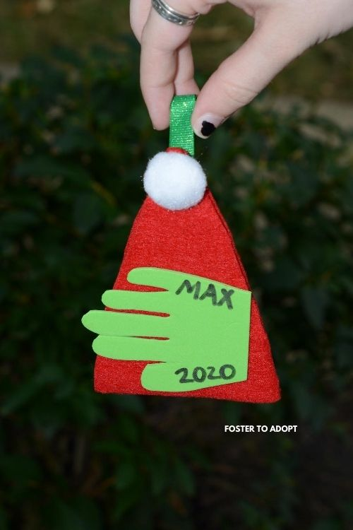 baby handprint ornament for kids to make for Christmas crafts.