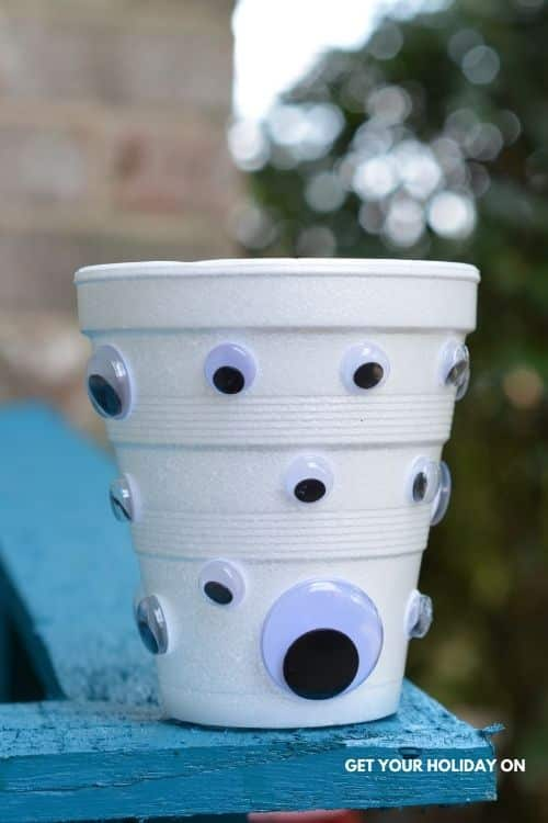 Example of what the cup looks like with the eyeballs glued on to it for this craft idea.