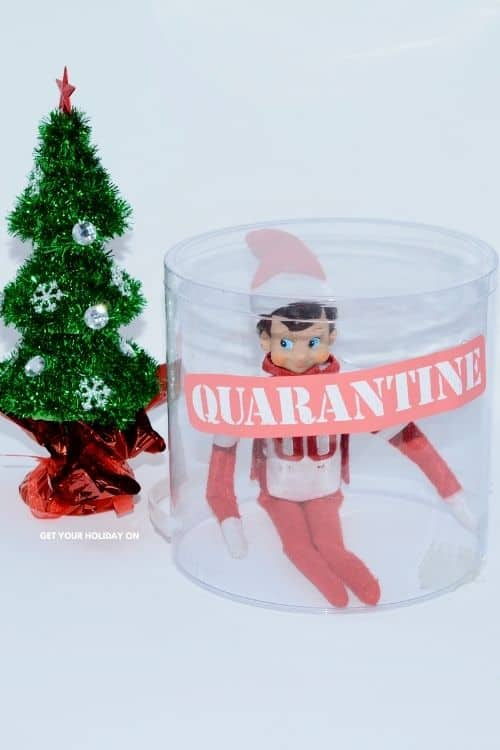 Elf put in clean container with a quarantine sign label.