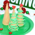 edible sugar cones with green icing and edible decorations on top.