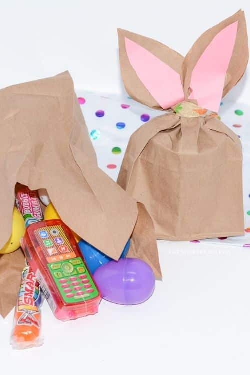 The paper Easter bunny bag filled with goodies and candy treats.